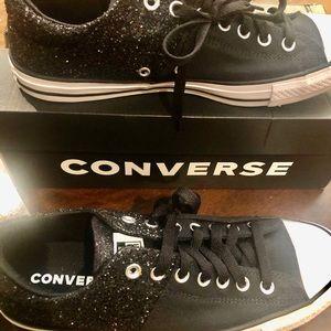 Black glitter converse.